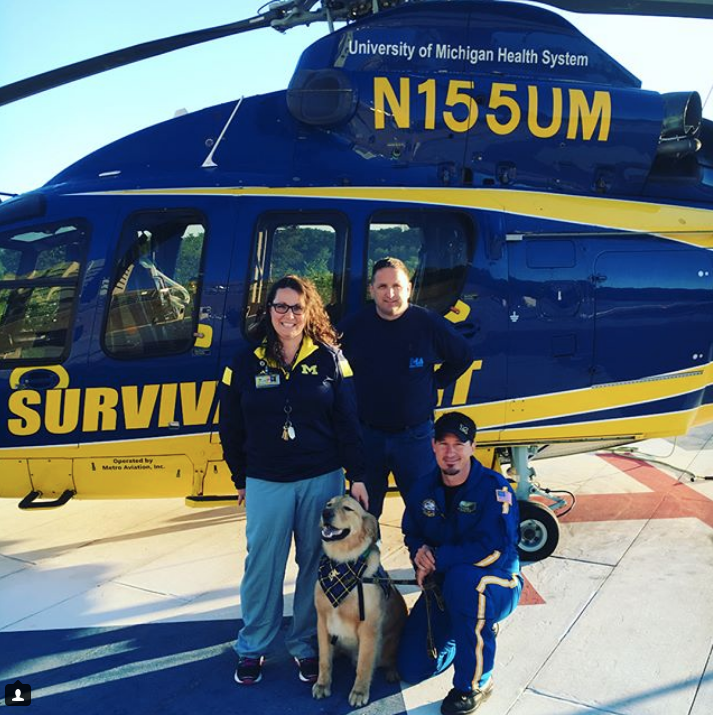 Denver hangs out with some survival flight crewmembers.