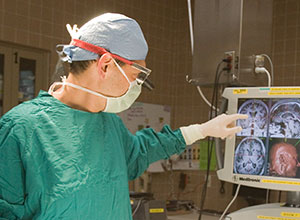Oren Sagher consults the new MRI imagery in the operating room