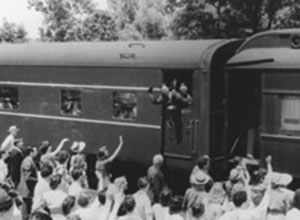 A train carrying members of the 298th leaves Ann Arbor