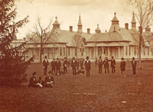 Men gather on the lawn behind the Pavilion Hospital, circa 1877