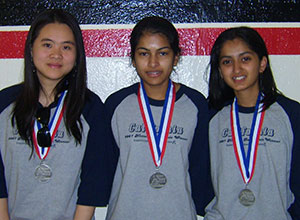 Khanh Nguyen, Nazeela Sabir and Ashleen Kishore wearing the medals they received at National History Day