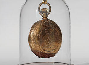 Bearing an engraving of a regal buck, Stowell's watch is a symbol of the department's legacy.